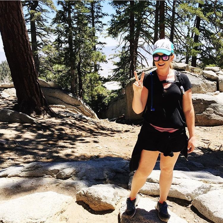 Woman with peace sign and sunglasses on the San Jacinto Trail