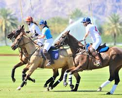 Three polo players during a match at Eldorado Polo