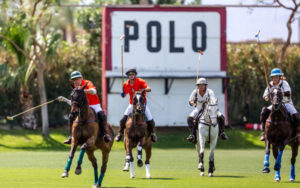 Four polo players during a match at Empire Polo