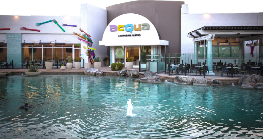 Front of Acqua California Bistro with fountain in front