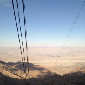 View from the the Palm Springs Aerial Tram car with the tram cables and the Coachella Valley's desert landscape in the background