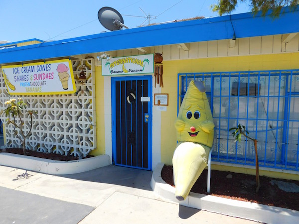 Exterior of the banana museum, a yellow building with blue trim