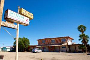 "Sign reading""Ski Inn World Famous Lowest Bar in the Western Hemisphere"""