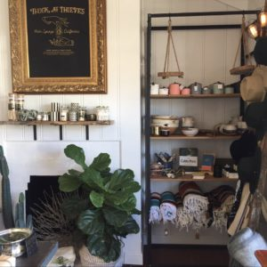 Corner of Thick and Thieves displaying a bookshelf of various items for sale
