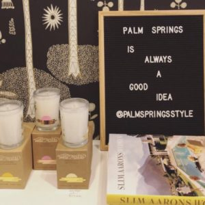 Display at the Palm Springs Style Shop with candles and a felt board