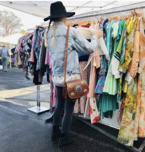 Woman shopping at Palm Springs Vintage Market