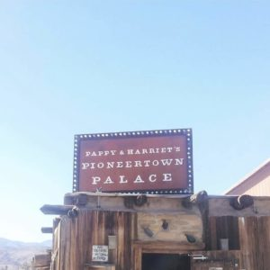 "Sign reading ""Pappy & Harriet's Pioneertown Palace"""