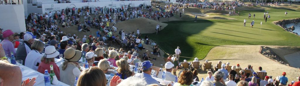 Audience overlooking golf course during ongoing tournament