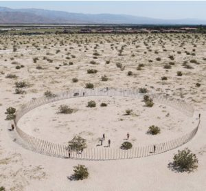 Aerial shot of Desert X exhibit in the middle of the desert