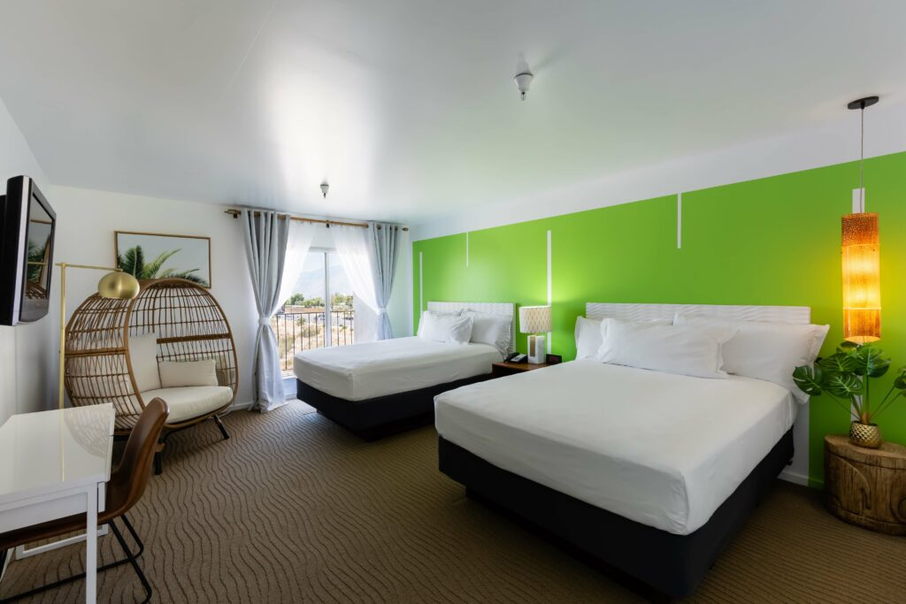 room with 2 queen beds with green patterned wall